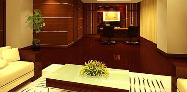 The interior of an executive office with white furniture and polished wood floors.